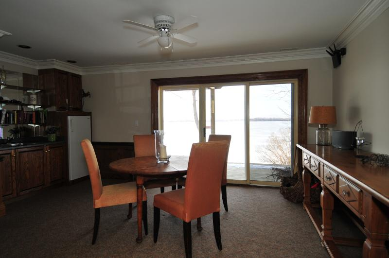Card playing room overlooking the water with wet bar.