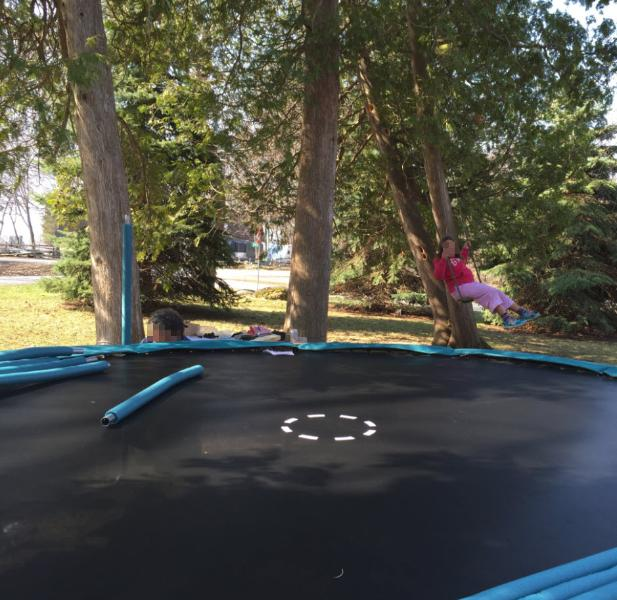 Large trampoline with enclosure