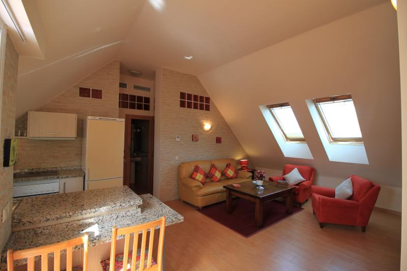 View of the lounge and kitchen, dormer windows