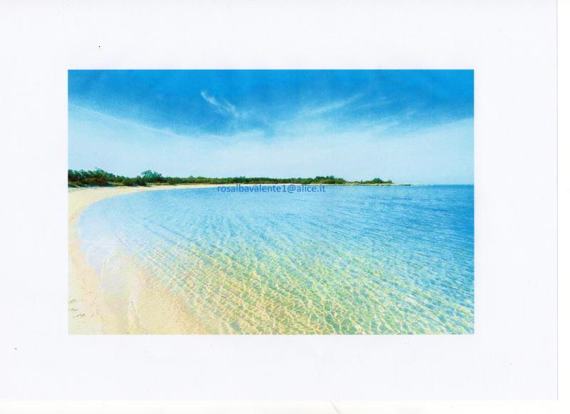 spiaggia baia verde, nel fondo il Pizzo