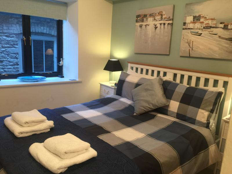 Comfy double bedroom with views to the cobbled lane