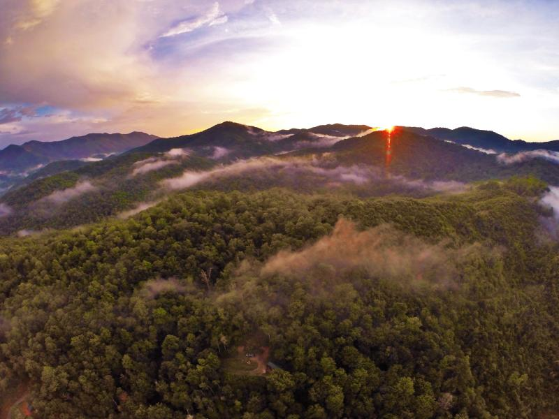 A drone's perspective of the cabin and our back yard - the Nantahala National Forest at sunset.