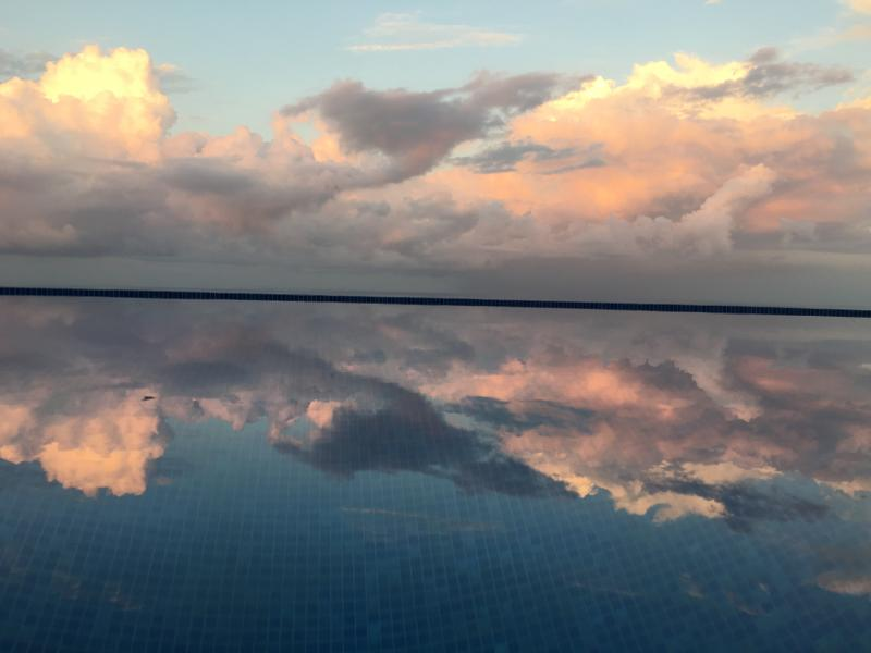 Sunset sky reflected in the pool.