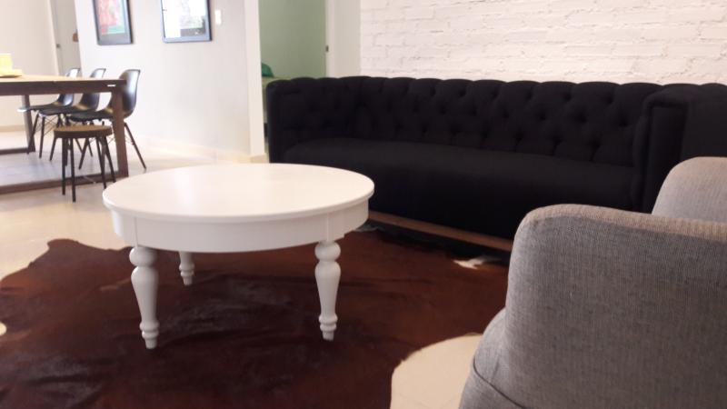 Black Sofa & white bricks