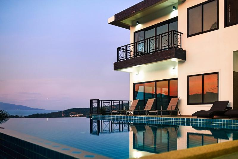 swimming pool sunbed house view sunset view