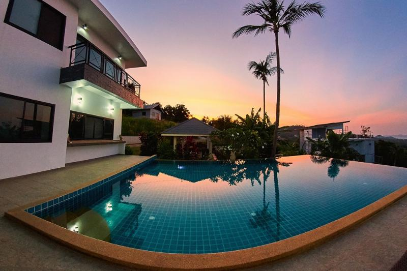 swimming pool sunbed view sunset view