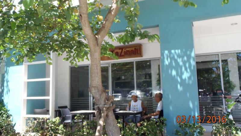 Internet Cafe Tazimah with outdoor patio chairs to enjoy the warm weather