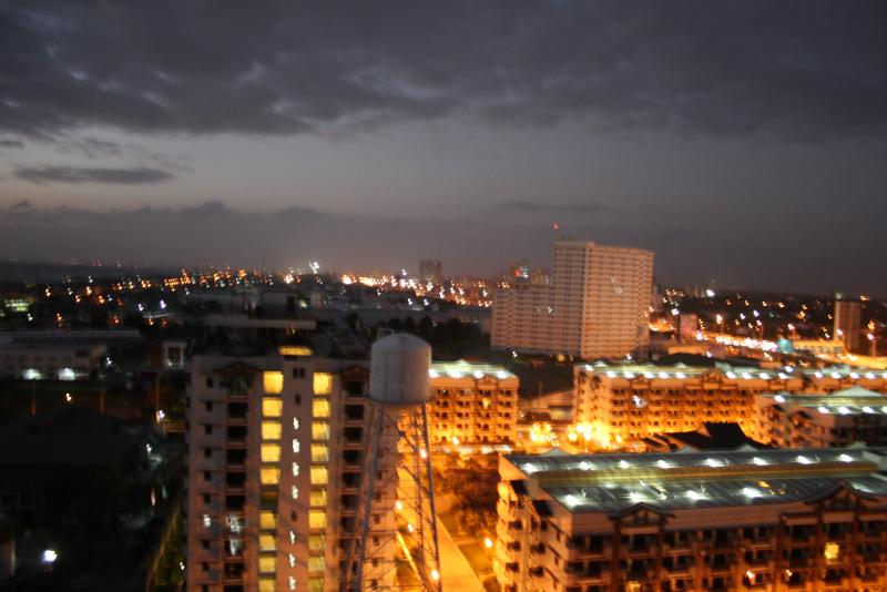 View from T16 at night lights of the city and surrounding condo buildings