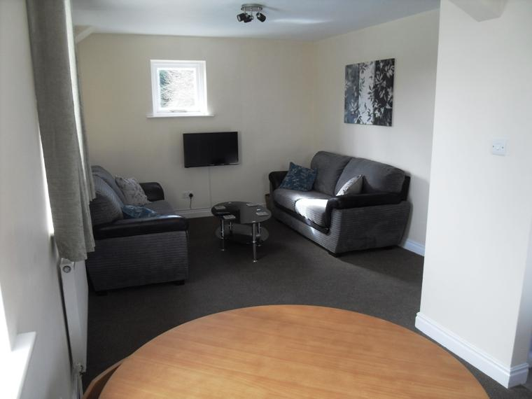 Comfortable dining/ sitting area with free view TV and free Wi Fi