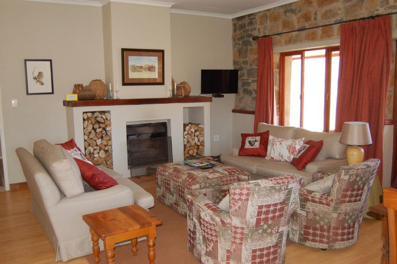 Lounge with open fireplace - Watersmeet Cottage