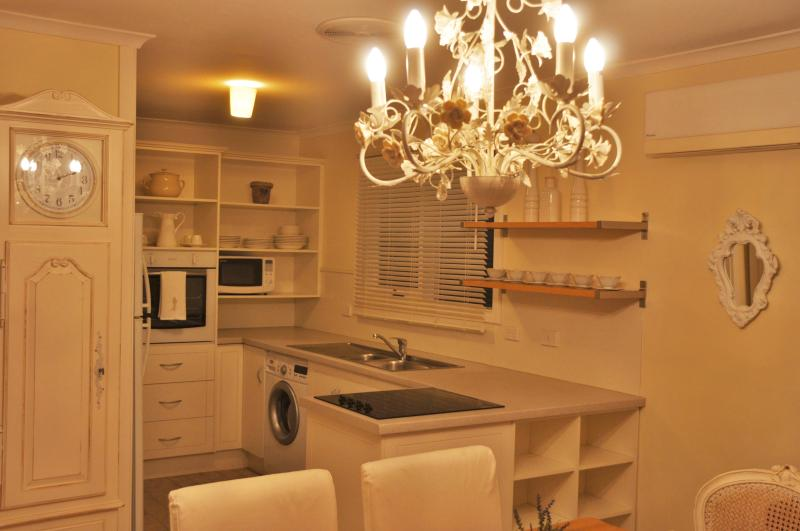 Modern, fully equipped kitchen with front load washing machine.