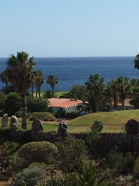 Beautiful view across the golf course and sea from the lounge.