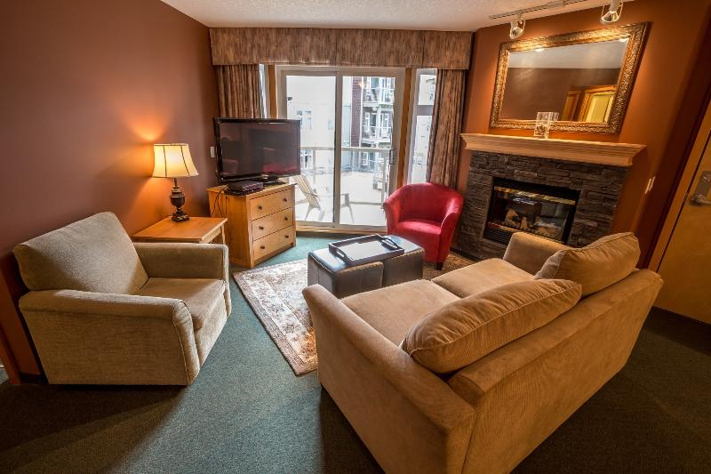 Comfortable, cozy living area with fireplace and patio doors with deck access!