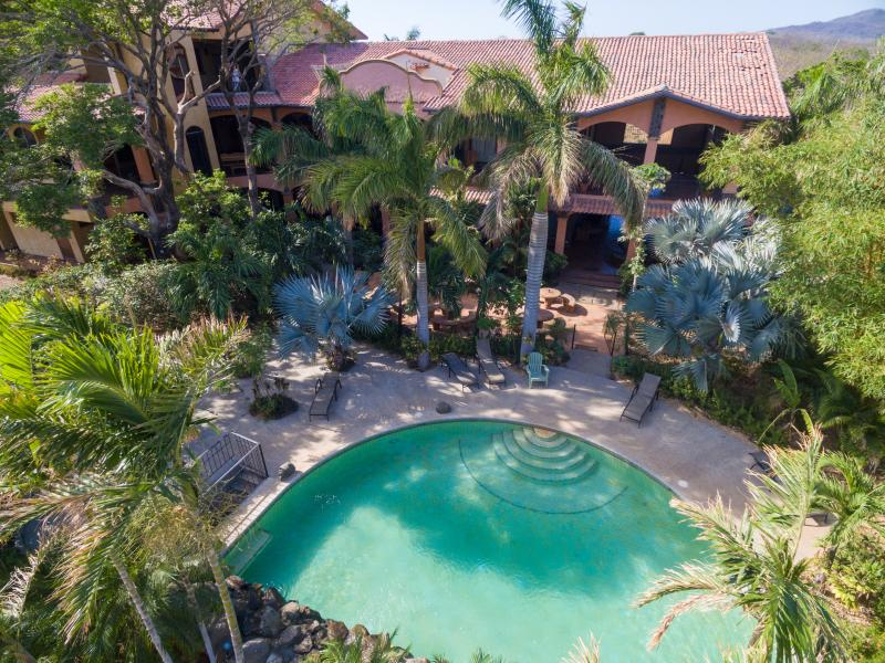 Lush pool and gardens for condo guests