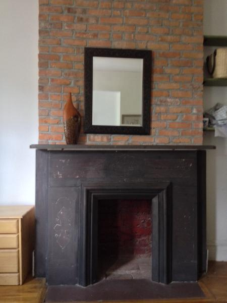Ornamental fireplace in bedroom