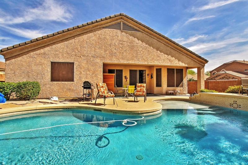 Soak up the marvelous Arizona sunshine next to the home's sparkling private swimming pool in the backyard