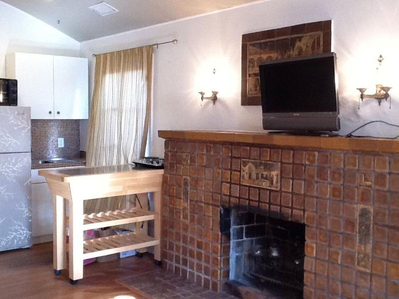 Spanish tile fireplace and wood floor