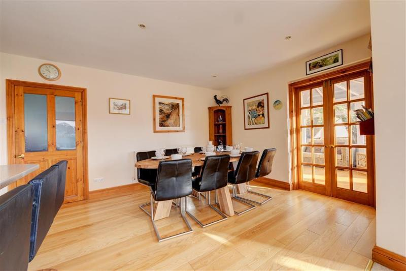 Open plan dining area leading to sunny conservatory