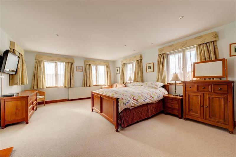 Master en suite bedroom with linen and bed made up for guests arrival.