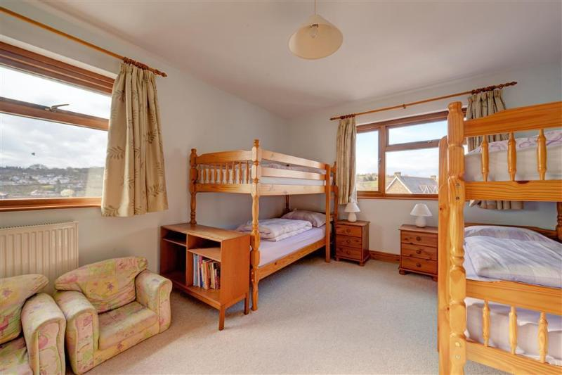 Double bunk bedded room with sea views and beds made up for guests arrival