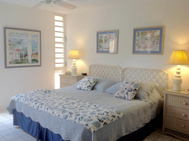 King sized master bedroom decorated in soothing shades of blue