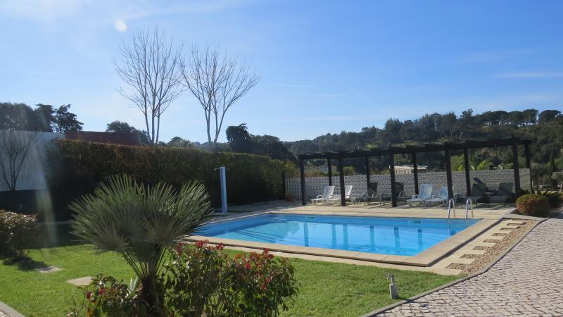Piscina com deck privativo