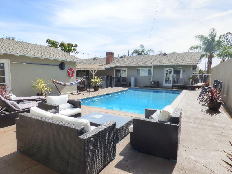 Large Backyard and pool area with plenty of seating for the whole family.