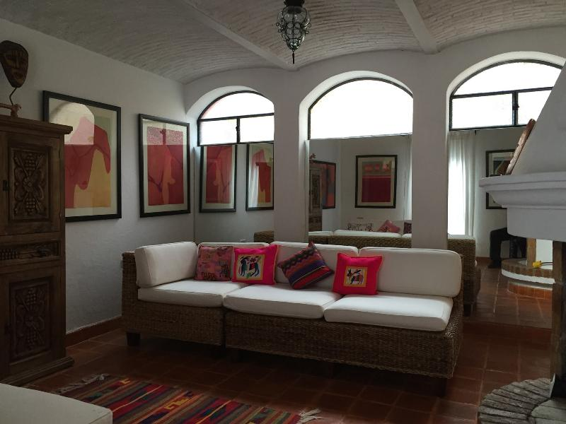 Living room with mirrored back wall, open the windows for nice breezes