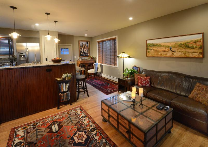 Living room with writing desk and wet bar