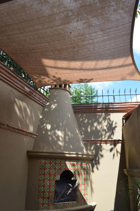 Fabric sail over back portion of patio protects you from sun and birds!