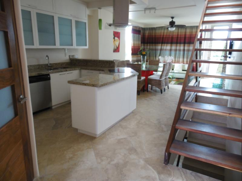 Fully equipped kitchen and living-dinning room. Bedrooms are located downstairs.