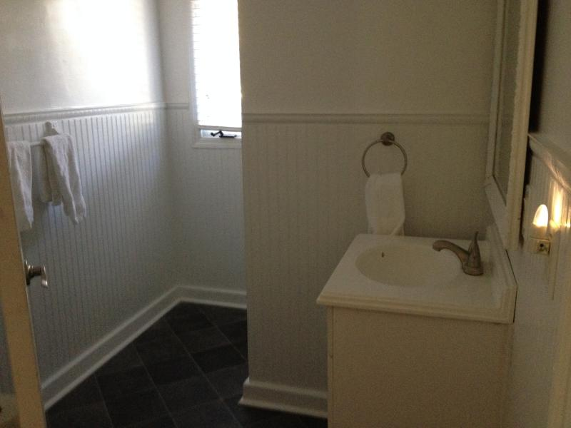 Second Floor bath with shower, sink and toilet