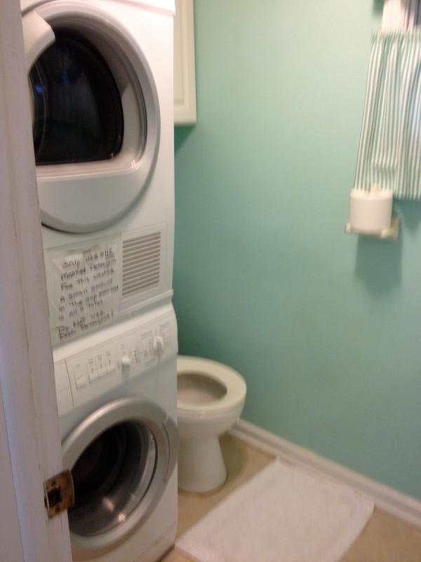 Half bath off the kitchen with washer/dryer