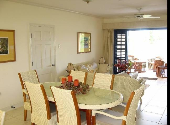 Living and Dining area that opens out onto patio with views of golf course.