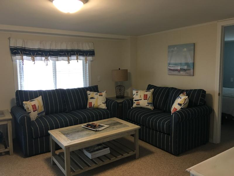 Family room with sleeper sofa. Has direct access to the back yard.
