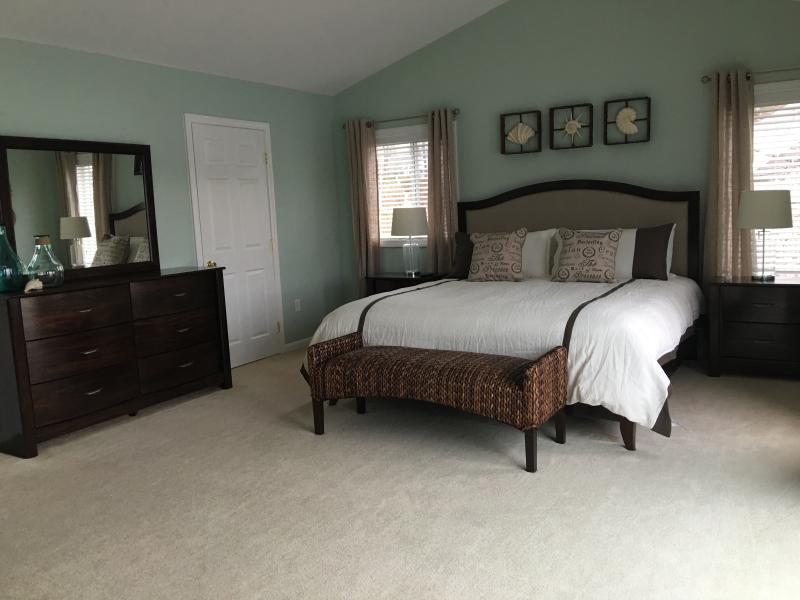 Luxurious second floor master bedroom with ensuite and king-sized bed.