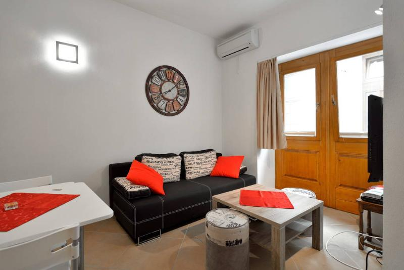 Sofa in air conditioned ground floor daily room which can be converted to double bad