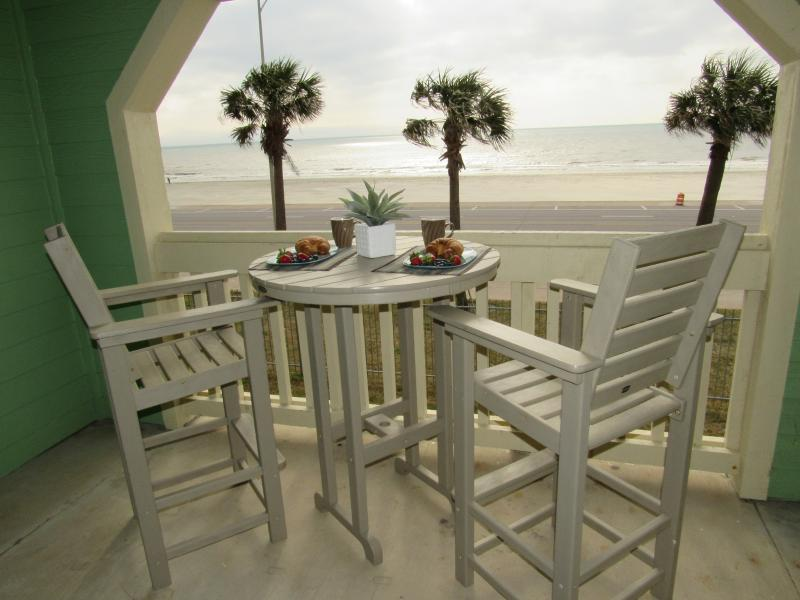 View from our patio overlooking beach and gulf on the seawall.