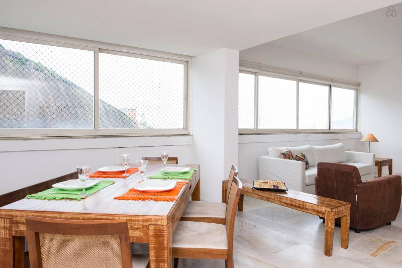 Living and dining room with tv and ac + amazing view