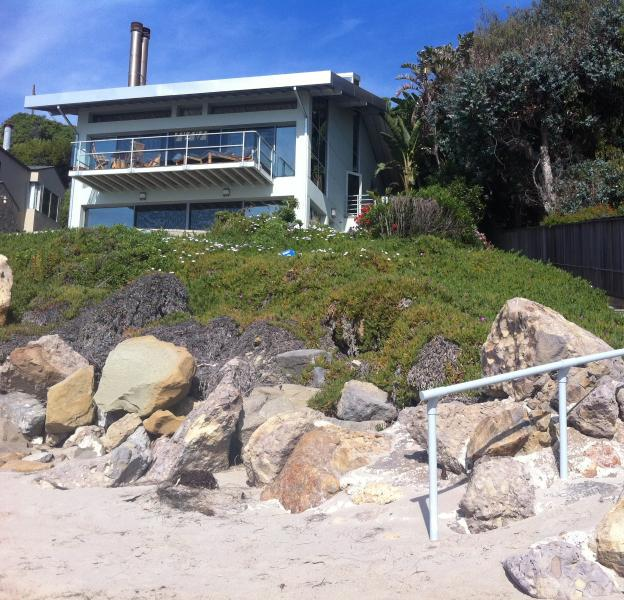 A view of the house from the sandy beach