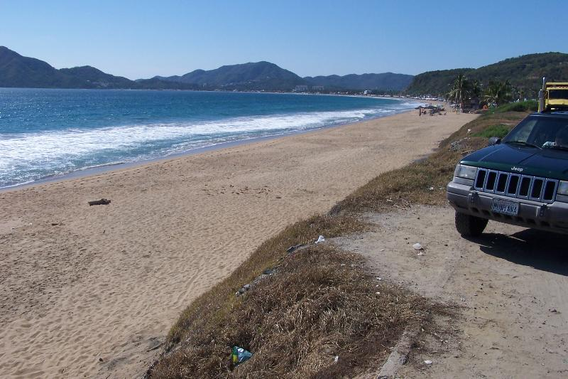 The beach at Santiago Bay. Close to Vida, great swimming and  miles of sand.