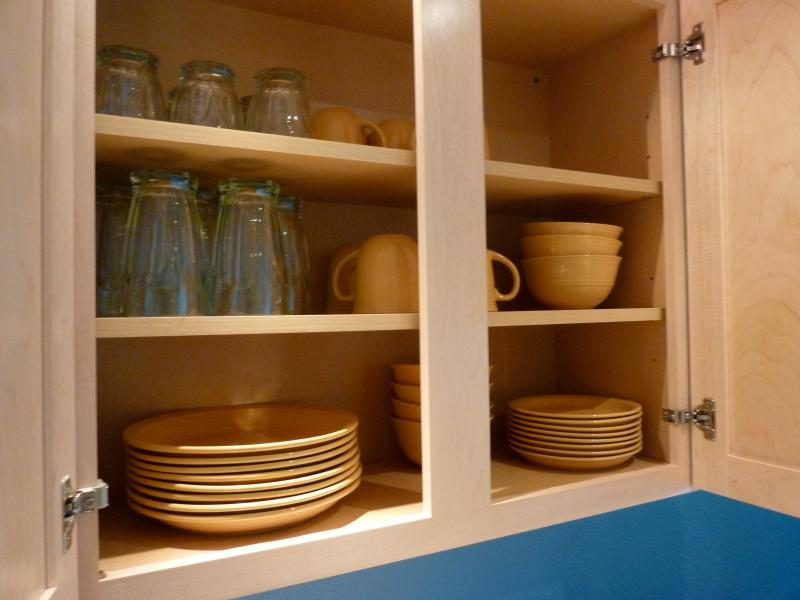 Cupboards are filled with plates and glasses