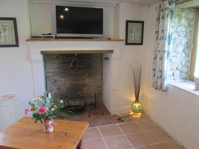 TV and lounge area, single bed can be added here if required. Travel Cot also available.