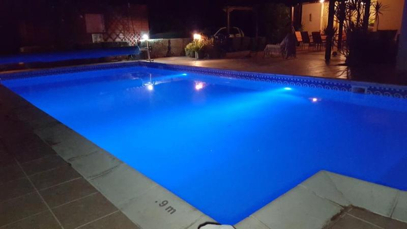 The sparkling 10m x 5m pool at night.