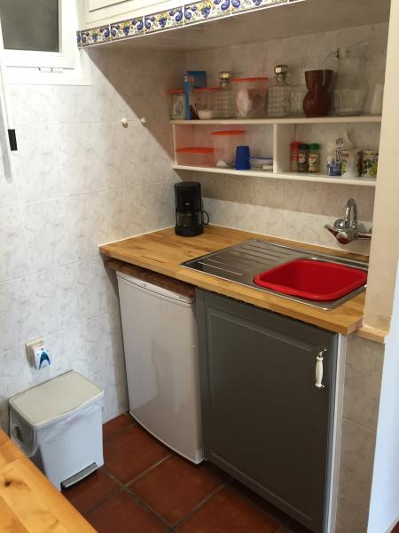 Kitchen with sink, freezer and coffee machine.
