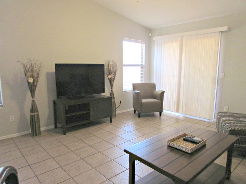 Living room with 50' HDTV and queen size sofa sleeper w/ memory foam mattresss