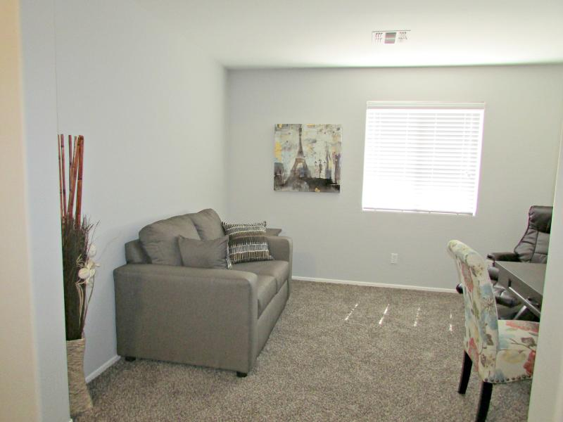 Master suite lounge area w/ desk and office chair