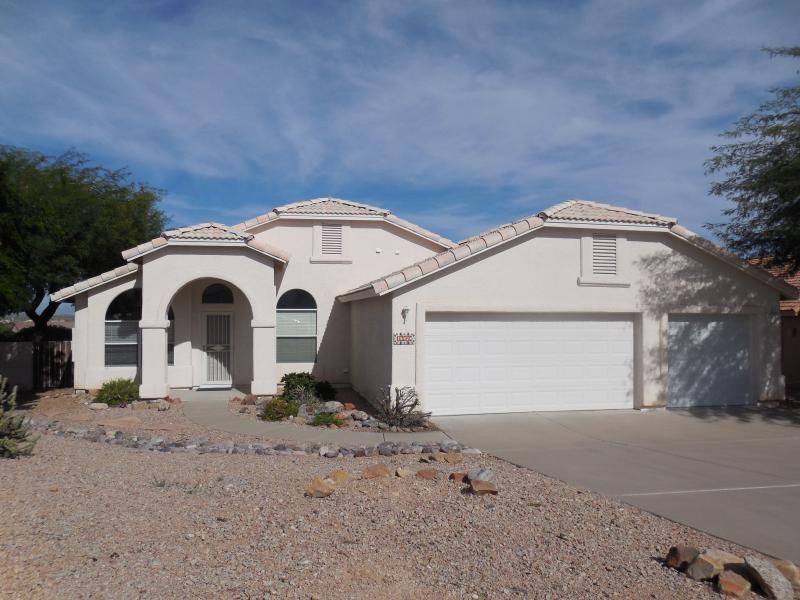 Front of Home  w/ 3 Car Garage, fenced yard and mountain/fountain views