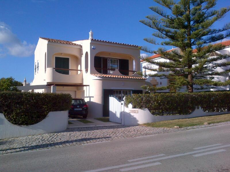 Front of Villa with car parking and security gates