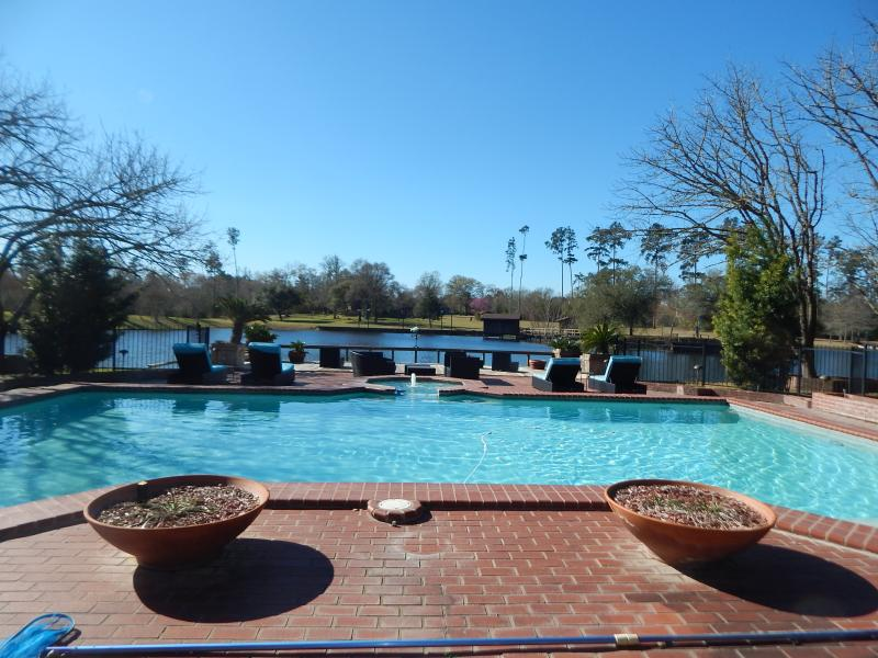 HUGE in-ground pool overlooks private 6.5 acre lake! Watch beautiful sunsets from this deck, or fish